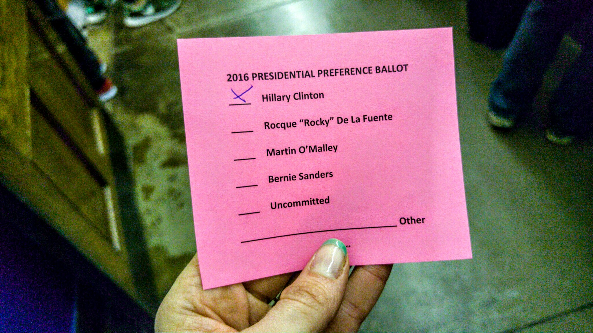 "My ballot. Casting my vote was a very open, formal process. I was handed this small piece of paper and after finding a pen in my purse, I selected my candidate and dropped the ""ballot"" in a cardboard box."
